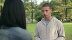 Relationship difficulties, couple fighting in the park, steadicam shot HD Stock Footage