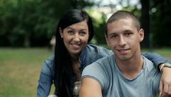Happy teenage couple in love in the park, steadicam shot HD - stock footage