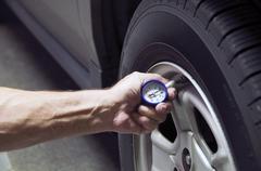 Tire Presure Check - stock photo