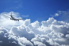 Jet aircraft in a cloudy sky Stock Photos