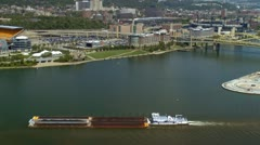 Tugboat pushing barge past Allegheny river in Pittsburgh Stock Footage