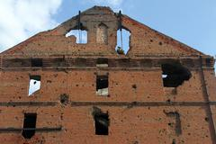 facade of red brick mill - stock photo