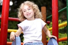 Young girl  slide Stock Photos