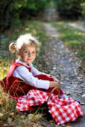 Pretty little girl in the woods - stock photo