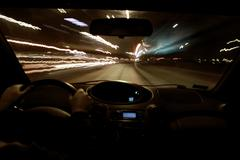 Night ride in car - stock photo