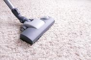 Stock Photo of vacuuming