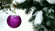 Snow falls on Christmas decoration Stock Footage