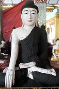 wihite buddha with dark robe - stock photo