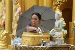 woman wash buddha - stock photo