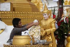 Girl and buddha Stock Photos
