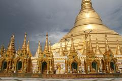 Dark cloud and shwe dagon pagoda Stock Photos
