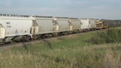 Railway, freight train eastbound, hoppers, gondola, tank, medium shot Stock Footage