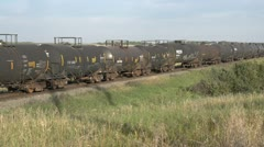 Railroad, freight train eastbound wide on tanker cars, medium shot Stock Footage