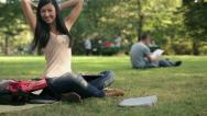 Young student with laptop relaxing in the park, steadicam shot HD Stock Footage