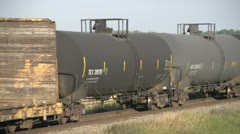 Railway, freight train eastbound tight on tanker and auto carrier cars Stock Footage