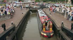 Canal boat enters lock at stratford upon avon Stock Footage