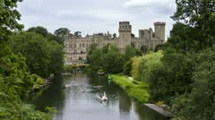 Time lapse of swan pedalos on River Avon, Warwick castle Stock Footage