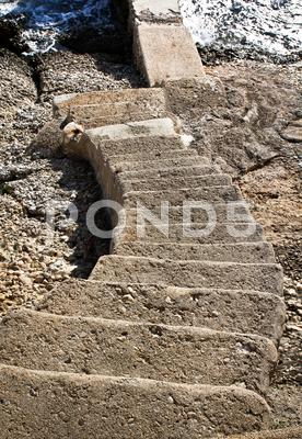Stock photo of stairs going down to water