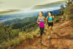 Hispanic women running in remote area Stock Photos