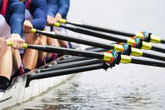 close up of men's rowing team - stock photo