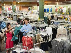 Caucasian couple shopping in clothing store Stock Photos