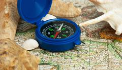 old map and compass - stock photo