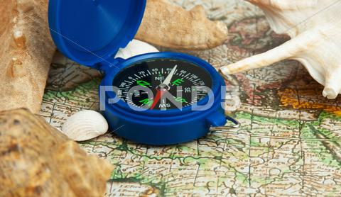 Stock photo of old map and compass