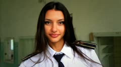 Beautiful girl posing for the camera in clothing cadet. 8. - stock footage