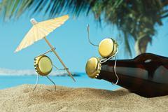 funny bottle cork on a sandy beach - stock photo