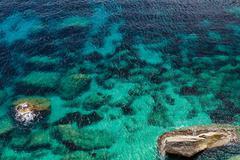 Blue rocky sea Stock Photos