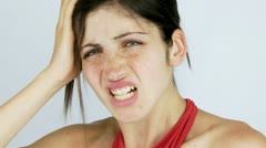 Beautiful girl with strong headache looking into camera closeup Stock Footage
