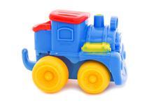Toy a plastic nursery, a steam locomotive of bright shades. Stock Photos