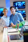 people buy  in consumer electronics store - stock photo