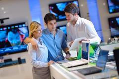 People buy  in consumer electronics store Stock Photos