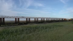 Railroad, slow train, special welded rail cars, 1400' sections of welded rail Stock Footage