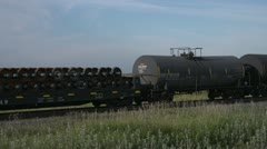Railroad, slow train flatbed and LPGs Stock Footage