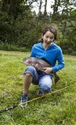 happy girl fishing - stock photo