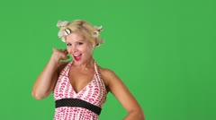 Closeup young woman with rollers in her hair being funny and blowing kisses Stock Footage