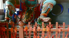 Chinese immortals Buddhist Vajra sculpture in carved beams painted buildings,ma Stock Footage