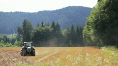 Tractor on meadow Stock Footage