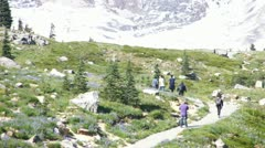 Hikers approach the Nisqually Glacier - stock footage