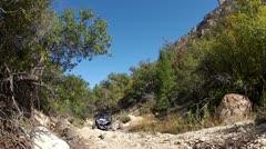 4x4 sport UTV climbs rocky mountain trail HD 017 Stock Footage