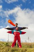 Couple Of Paragliders Dressed Up In Typical Wind Protective Outfit Stock Photos