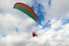 Tandem Paragliding With The Passenger In The Front And The Pilot In The Back - stock photo