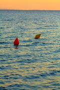 Red and yellow buoys during sunset Stock Photos