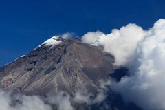 Tungurahua Volcano Eruption Against Clear Blue Sky In Ecuador South America Stock Photos