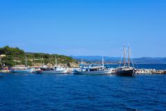 Boats near ouranopolis, athos peninsula, mount athos, chalkidiki, greece Stock Photos