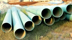 Pipes at construction site in sunshine Stock Footage