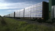 Stock Video Footage of railway, freight train to vanishing point, boxcars, bulkhead flatbed