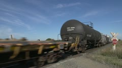 Railway, freight train rural gravel level crossing close, tank, hopper, flatbed Stock Footage